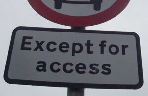 Part of a road sign that reads, 'Except for access'.