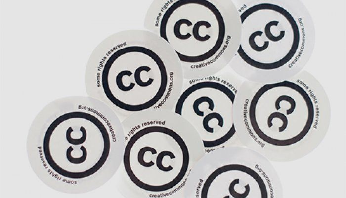 A photo of eight Creative Commons stickers arranged on a white background. Each sticker includes the Creative Commons 'two Cs in a circle' symbol with the words, 'Some rights reserved' and the CC website address.